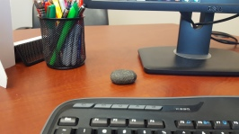 rock at desk